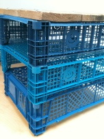 blue crates reinvented into a table by a first year product designer